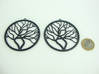Tree Big Hoop Earrings 60mm 3d printed Tree Big Hoop Earrings 60mm printed in Black Strong & Flexible with 1€ coin for scale.
